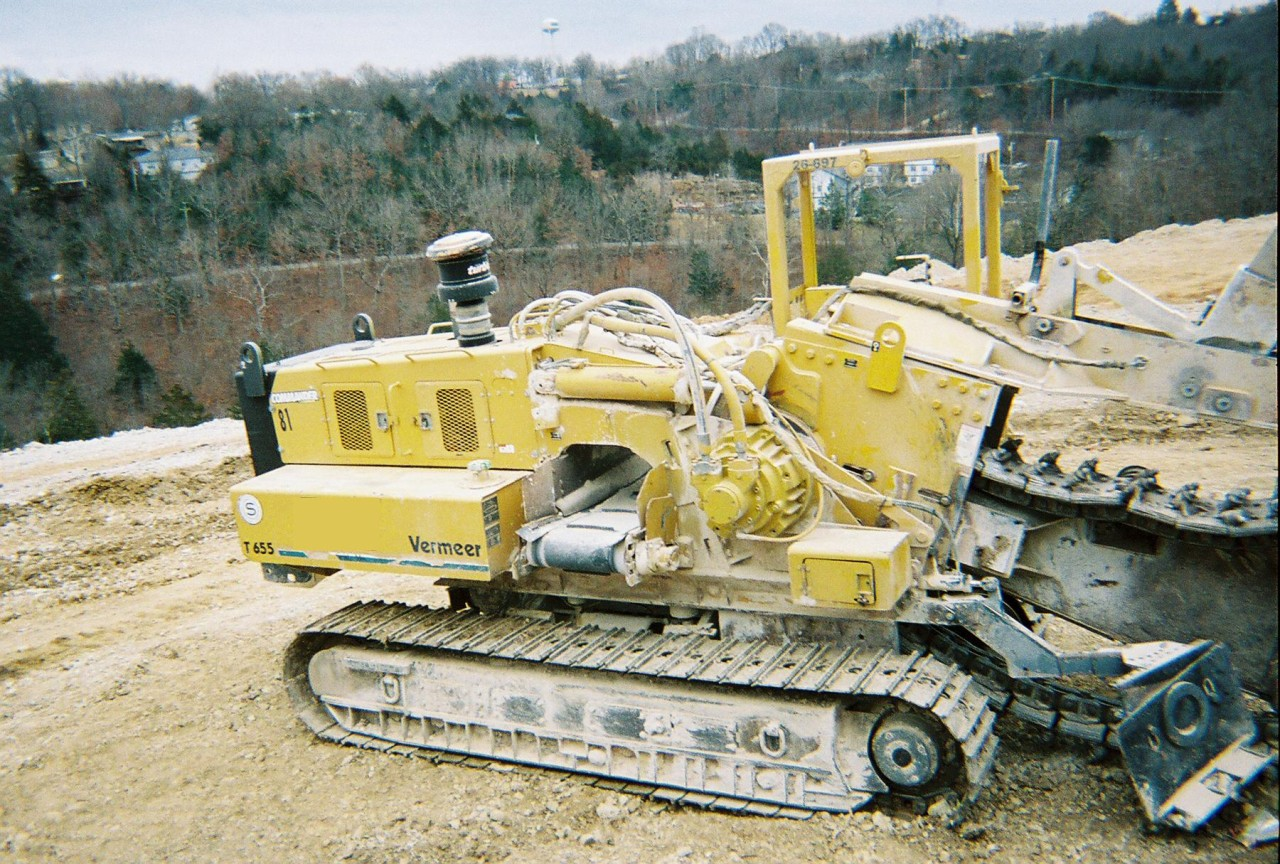 This 2000 Vermeer T655 trencher from Garner Equipment makes an 18-inch cut, six feet deep, with hydraulic burm scraper and hydraulic crumber.